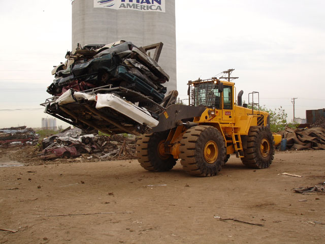 The recycling center will store the crushed cars on their lot until they have been scheduled to be shredded